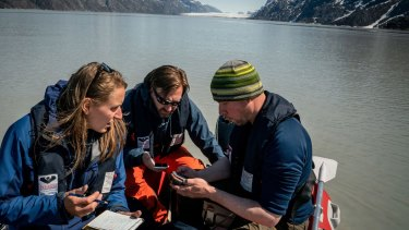 Scientists prepare to collect sediment samples a few miles up the Sermilik Fjord.