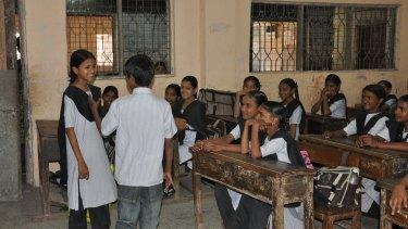 Children role-play during a gender equality class in a government school in Mumbai.