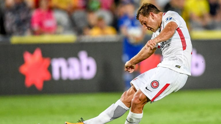 Drought-breaker: Brendon Santalab scores for the Wanderers against the Mariners.