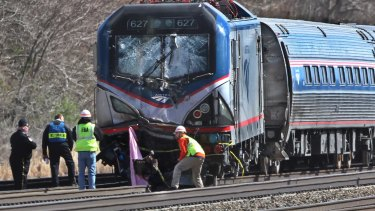 Amtrak investigators inspect the damaged train in Chester, Pennsylvania.