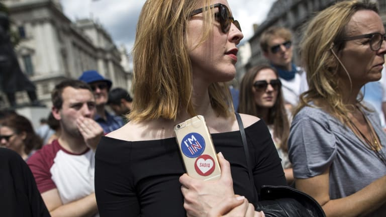 A small group of young people gather to protest on Parliament Square the day after the majority of the British public voted to leave the European Union.