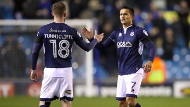 Lion's den: Millwall's Ryan Tunnicliffe (left) and Tim Cahill shake hands after the final whistle.