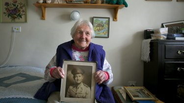 Mrs Doris Johnson, 91, with a photo of her late husband Neville Johnson.
