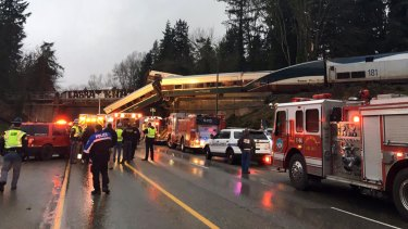 Emergency services at the scene after an Amtrak train derailed south of Seattle.