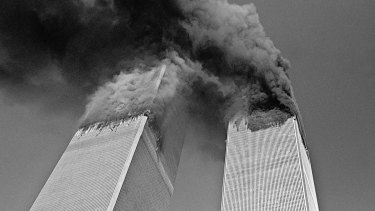 Smoke billows from the twin towers of the World Trade Center on September 11, 2001.