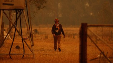 CFA Fireman Rodney Ridd as the Murrindindi fire approaches his property in February 2009.
