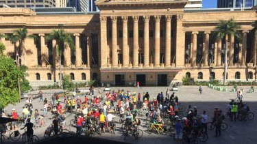 The pedal-powered protesters then gathered outside City Hall, where they made plans to do a similar demonstration during August.