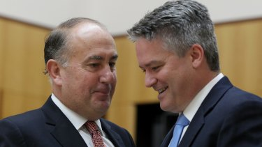 Secretary of Treasury John Fraser and Finance Minister Senator Mathias Cormann.