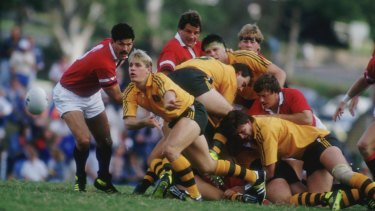 Brian Smith clears the ball during a Rugby World Cup pool match between Australia and the USA in Brisbane in 1987.