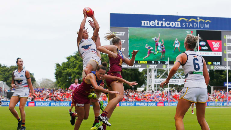 Erin Phillips takes a spectacular high mark for the Adelaide Crows during the AFLW grand final.