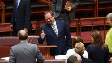 Senator Ricky Muir gives the thumbs up to Senate Leader Eric Abetz after he made his inaugural speech on Thursday.