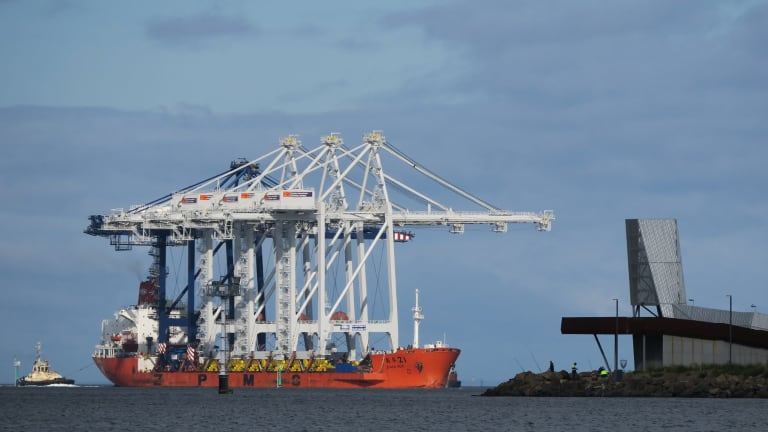 A container ship arrives at the Port of Melbourne.