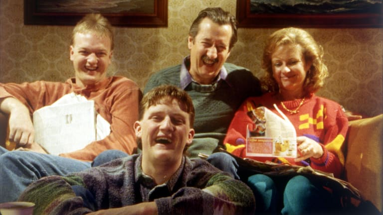 The Kerrigan household: Steve (Anthony Simcoe), Darryl (Michael Caton), Sal (Anne Tenney) and, in front, Dale (Stephen Curry).