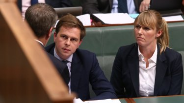 Opposition Leader Bill Shorten consults advisers Ryan Liddell and Kimberley Gardiner during question time last year.