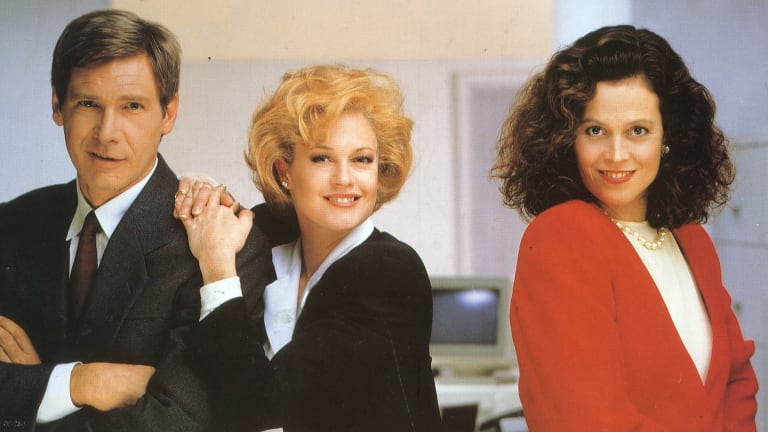 From left, Harrison Ford, Melanie Griffith  and Sigourney Weaver in the movie <i>Working Girl</i>.