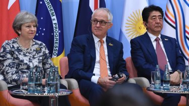 Malcolm Turnbull with Britain's Prime Minister Theresa May and Japan's Prime Minister Shinzo Abe at the G20 Summit in Hamburg.