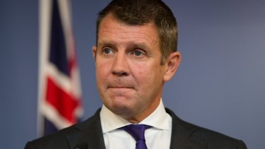 Premier Mike Baird is emotional at a press conference announcing his resignation.