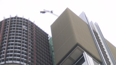 The crane dangling from Barangaroo's Tower One.