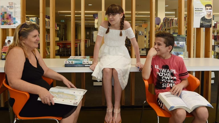 Donna West with her children Timmi Boughner, 11, and Brandon Boughner, 12, at the Mount Druitt Hub.
