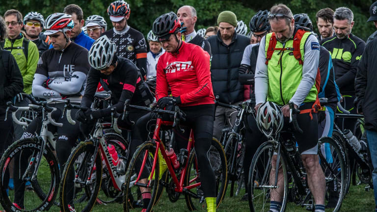 Hundreds of Canberra cyclists attended a memorial for British champion Mike Hall after his death during the Indian Pacific Wheel Race last year.