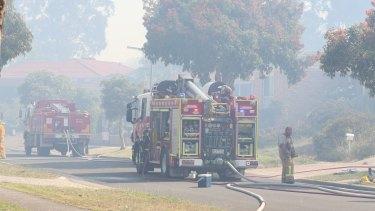 Fire trucks in Barnett Avenue, Carrum Downs.