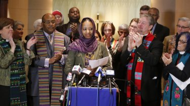 "Larycia Hawkins, centre, a professor at  Wheaton College, is greeted with applause from supporters at a news conference on December 16 after being placed on leave. Dr Hawkins, a Christian teaching political science at the private evangelical school west of Chicago,  began wearing a hijab to counter what she called the ""vitriolic"" rhetoric against Muslims in recent weeks."