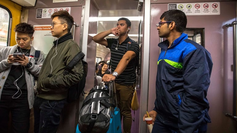 Passengers standing on the train from Central to the Blue Mountains.