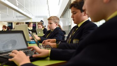 James Watt age 11 (3rd from right) amongst his fellow students at Inaburra School doing his school work in the Stage 3 Learning Centre where Years 5 & 6 consisting of 4 classes are combined in one learning space.