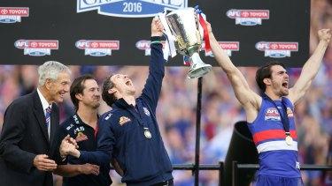 Luke Beveridge, Robert Murphy and Easton Wood of the Bulldogs celebrate the moment.