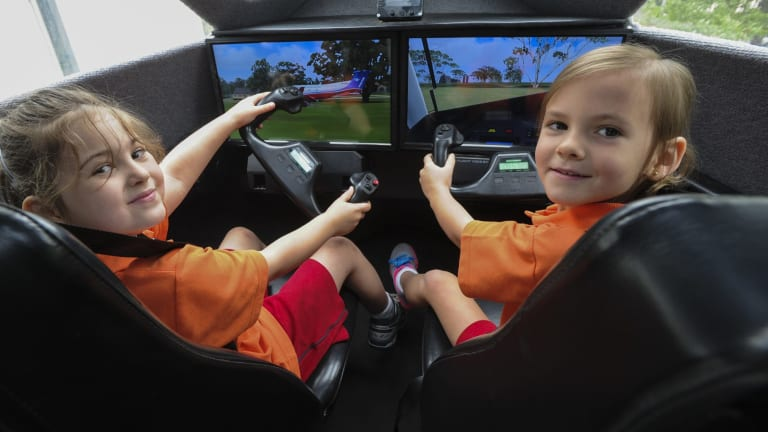 """""""Pilot to co-pilot"""", five-year-olds, Alannah Amos, left, and Khloee Owen take the controls."""