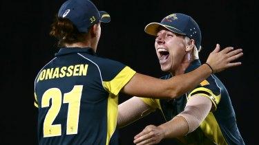 Elyse Villani (right) celebrates with Jess Jonassen (left) after the Aussie's win.