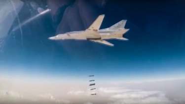 A Russian Tu-22M bomber unloads bombs on IS targets near Abu-Kamal, Syria.