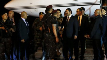 Lebanese Prime Minister Saad Hariri, center, escorted by his bodyguards upon arrival at the Rafik Hariri International Airport in Beirut.