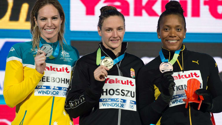 Podium: Silver medalist Emily Seebohm of Australia alongside Katinka Hosszu of Hungary and Alia Atkinson of Jamaica after the women's 100-meter individual medley.