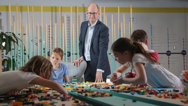 Nathan Jones, and his children, have found the school holiday program at his workplace, Insurance Australia Group, a boon.
