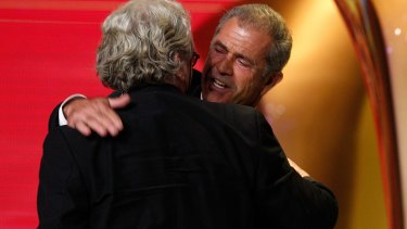 Mel Gibson congratulates George Miller on winning an AACTA Award.