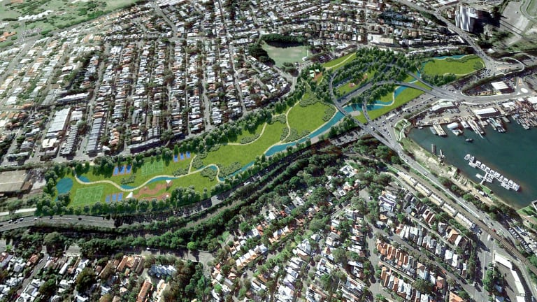 An artist's impression of the parkland planned to cover the existing Rozelle Rail Yards, under which a motorway interchange will be built.