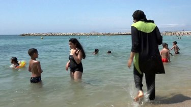 A Muslim woman enjoying the beach in Marseille.