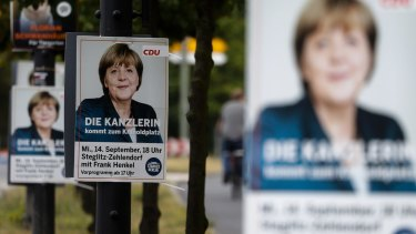 A poster with German Chancellor Angela Merkel, announcing an election rally of her Christian Democratic Union party for the Berlin state elections.