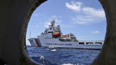 A Chinese Coast Guard ship attempts to block a Philippines government vessel as the latter tries to enter Second Thomas Shoal in the South China Sea.