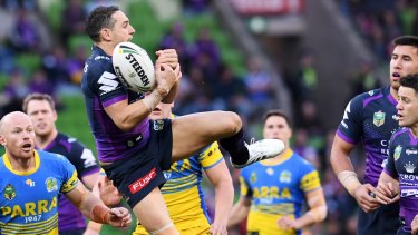Bombs away: Billy Slater juggles the ball against the Eels at AAMI Park.
