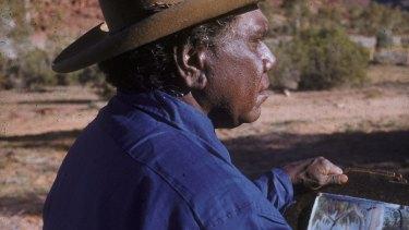 Albert Namatjira painting in the Australian outback.