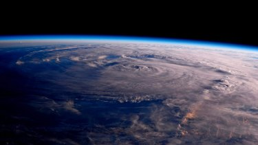 A photo taken from the International Space Station shows Hurricane Harvey over Texas on Saturday.
