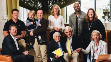 Canberrans doing good: (front row, left to right) Big Issue chief executive Steven Persson, Canberra soup kitchen's Stasia Dabrowsk, Snow Foundation chairman Terry Snow and board member Ginette Snow, (back row, left to right) YouthCare Canberra outreach worker Sach Bryers, Paul Dowden with son Sebastian, Snow Foundation chief executive Georgina Byron, One Disease's Sam Prince and Good360 chief executive Alison Covington.