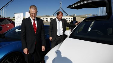 Urban Infrastructure Minsiter Paul Fletcher and Environment Minister Josh Frydenberg at an electric car event on the front lawn of Parliament House.