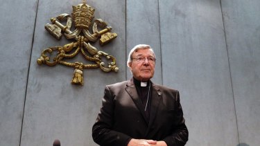 Cardinal George Pell arrives to make a statement at the Vatican on Thursday.
