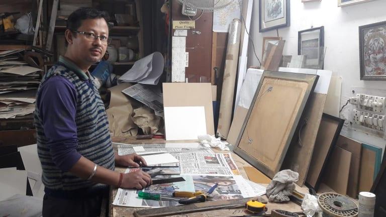 Picture framer Vimal Pradhan says if men won't change, women must.