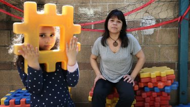 Childcare educator Patricia Rosas with five-year-old Antonella Blanco at the ABC childcare centre in Ultimo.