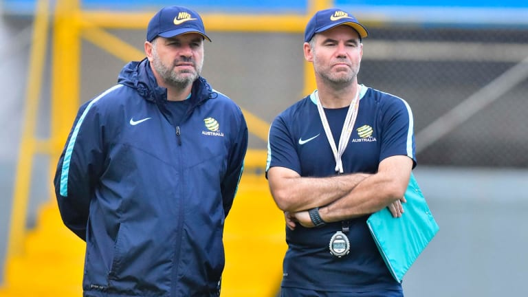 Tight-lipped: Socceroos head coach Ange Postecoglou with assistant Ante Milicic have given no clue as to their preferred line-up against Honduras.