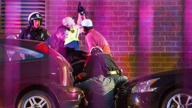 Dallas Police shield bystanders after shots were fired.